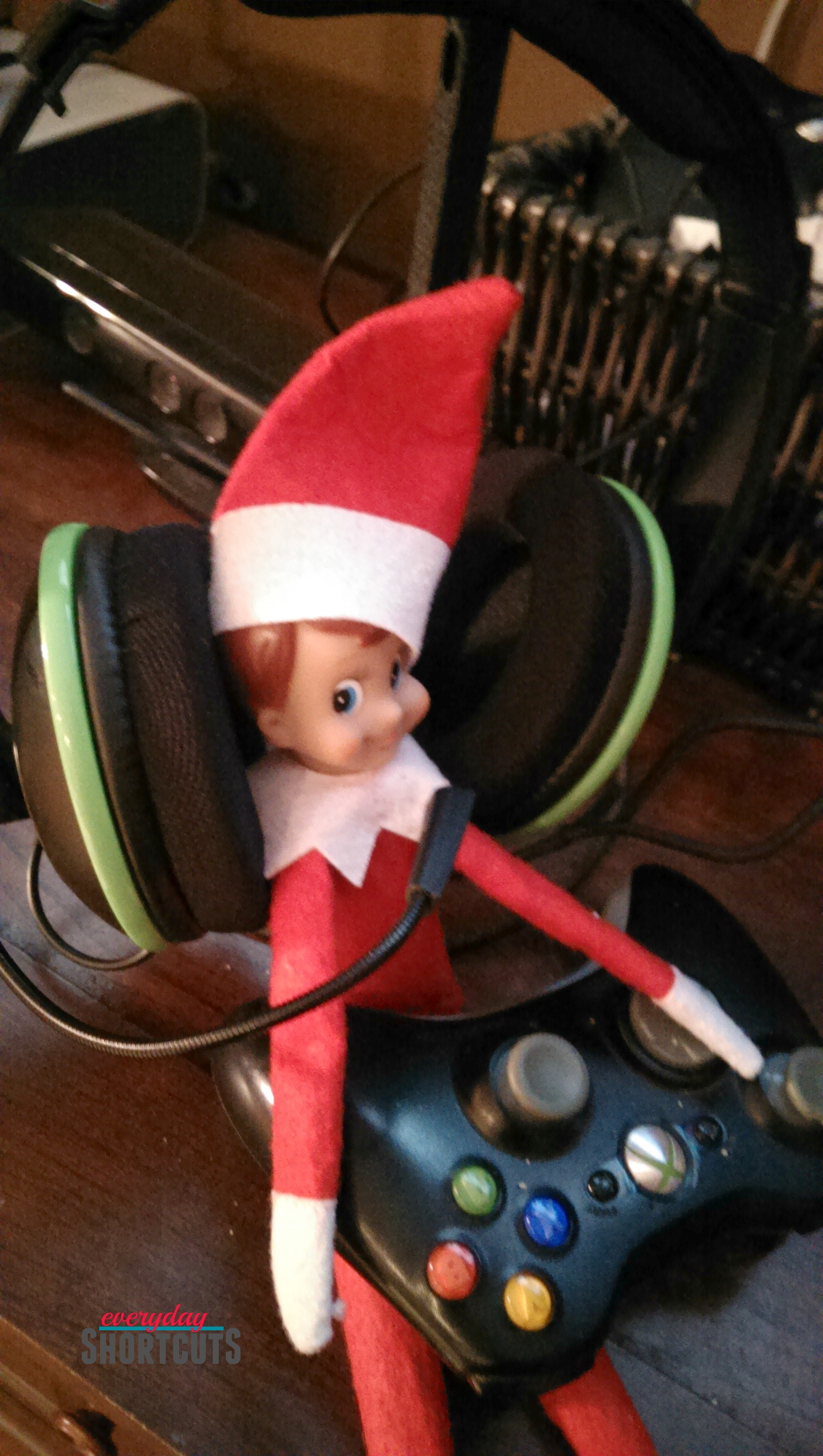 elf on the shelf with xbox controller and headphones