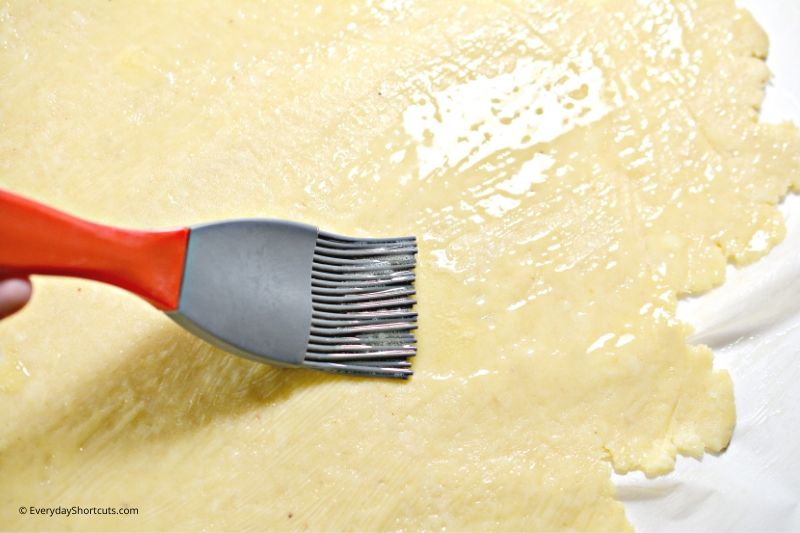 brush-keto-fat-head-dough-for-cinnamon-rolls